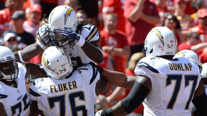 Sep 11, 2016; Kansas City, MO, USA; San Diego Chargers running back Melvin Gordon (28) is congratulated by guard D.J. Fluker (76) and guard Chris Hairston (75) after scoring a touchdown against Kansas City Chiefs linebacker Derrick Johnson (56) in the first half at Arrowhead Stadium. Mandatory Credit: John Rieger-USA TODAY Sports