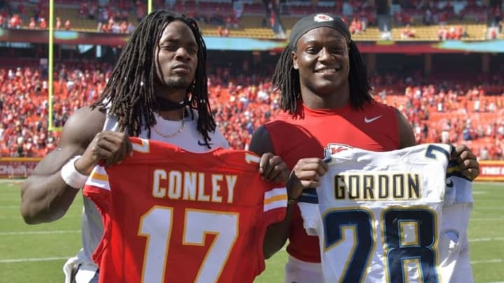 Sep 11, 2016; Kansas City, MO, USA; Kansas City Chiefs wide receiver Chris Conley (17) and San Diego Chargers running back Melvin Gordon (28) swap jerseys after the game at Arrowhead Stadium. The Chiefs won 33-27 in overtime. Mandatory Credit: Denny Medley-USA TODAY Sports