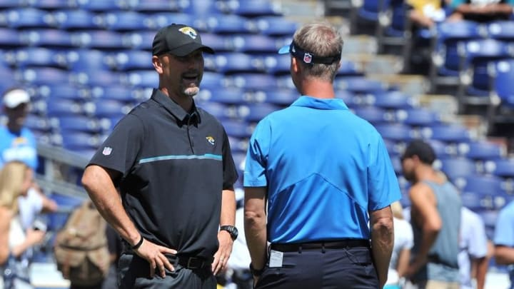 Sep 18, 2016; San Diego, CA, USA; Jacksonville Jaguars head coach Gus Bradley and San Diego Chargers head coach Mike McCoy talk before the game at Qualcomm Stadium. Mandatory Credit: Orlando Ramirez-USA TODAY Sports