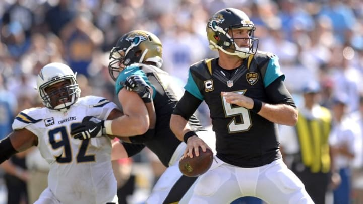 Sep 18, 2016; San Diego, CA, USA; Jacksonville Jaguars quarterback Blake Bortles (5) looks to pass as San Diego Chargers defensive tackle Brandon Mebane (92) works against offensive guard Luke Joeckel (76) during the third quarter at Qualcomm Stadium. Mandatory Credit: Jake Roth-USA TODAY Sports