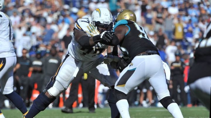 Sep 18, 2016; San Diego, CA, USA; San Diego Chargers tackle King Dunlap (77) blocks Jacksonville Jaguars defensive end Yannick Ngakoue (91) during the second half of the game at Qualcomm Stadium. San Diego won 38-14. Mandatory Credit: Orlando Ramirez-USA TODAY Sports