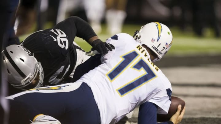 Dec 24, 2015; Oakland, CA, USA; Oakland Raiders nose tackle Denico Autry (96) sacks San Diego Chargers quarterback Philip Rivers (17) for a safety during the third quarter at O.co Coliseum. The Oakland Raiders defeated the San Diego Chargers 23-20. Mandatory Credit: Kelley L Cox-USA TODAY Sports