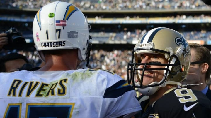 Oct 2, 2016; San Diego, CA, USA; New Orleans Saints quarterback Drew Brees (9) and San Diego Chargers quarterback Philip Rivers (17) shake hands after the Saints beat the Chargers 35-34 at Qualcomm Stadium. Mandatory Credit: Jake Roth-USA TODAY Sports