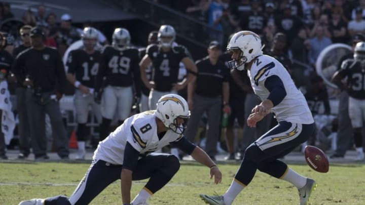 October 9, 2016; Oakland, CA, USA; San Diego Chargers punter Drew Kaser (8) misses the snap on a field goal attempt in front of kicker Josh Lambo (2) during the fourth quarter against the Oakland Raiders at Oakland Coliseum. Mandatory Credit: Kyle Terada-USA TODAY Sports