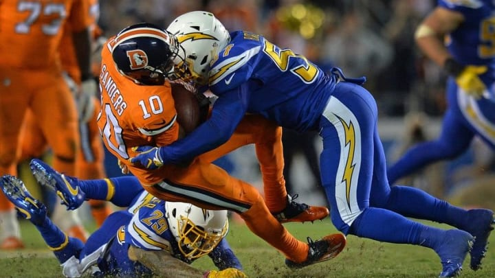 Oct 13, 2016; San Diego, CA, USA; Denver Broncos wide receiver Emmanuel Sanders (10) is tackled by San Diego Chargers inside linebacker Jatavis Brown (57) during the fourth quarter at Qualcomm Stadium. Mandatory Credit: Jake Roth-USA TODAY Sports