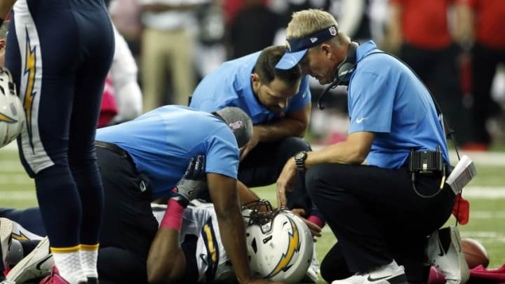 Oct 23, 2016; Atlanta, GA, USA; San Diego Chargers head coach Mike McCoy and training staff tend to defensive tackle Caraun Reid (91) after he was injured in the first quarter of their game against the Atlanta Falcons at the Georgia Dome. Mandatory Credit: Jason Getz-USA TODAY Sports