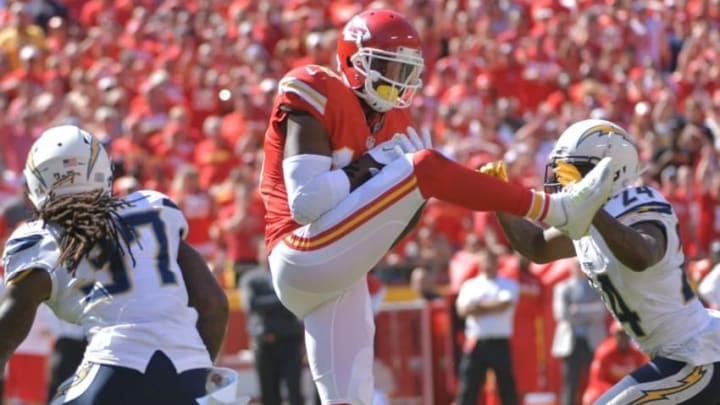 Sep 11, 2016; Kansas City, MO, USA; Kansas City Chiefs wide receiver Jeremy Maclin (19) catches a pass and is tackled by San Diego Chargers cornerback Brandon Flowers (24) during the second half at Arrowhead Stadium. The Chiefs won 33-27 in overtime. Mandatory Credit: Denny Medley-USA TODAY Sports