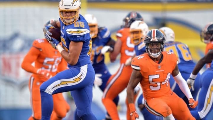 Oct 13, 2016; San Diego, CA, USA; San Diego Chargers tight end Hunter Henry (86) looks down field after making a catch as Denver Broncos inside linebacker Brandon Marshall (54) defends during the first quarter at Qualcomm Stadium. Mandatory Credit: Jake Roth-USA TODAY Sports