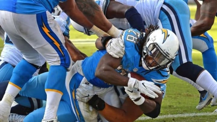 Nov 6, 2016; San Diego, CA, USA; San Diego Chargers running back Melvin Gordon (28) scores a touchdown as Tennessee Titans nose tackle Al Woods (96) defends during the third quarter at Qualcomm Stadium. Mandatory Credit: Jake Roth-USA TODAY Sports