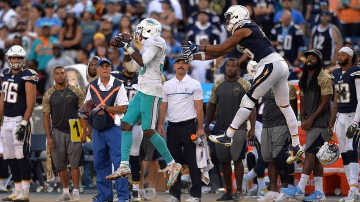 Nov 13, 2016; San Diego, CA, USA; Miami Dolphins cornerback Tony Lippett (36) intercepts a pass intended for San Diego Chargers wide receiver Tyrell Williams (16) during the fourth quarter at Qualcomm Stadium. Mandatory Credit: Jake Roth-USA TODAY Sports