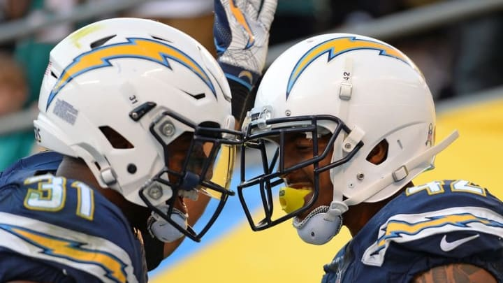 Nov 13, 2016; San Diego, CA, USA; San Diego Chargers strong safety Adrian Phillips (31) and cornerback Trevor Williams (42) celebrate during the fourth quarter against the Miami Dolphins at Qualcomm Stadium. Mandatory Credit: Jake Roth-USA TODAY Sports