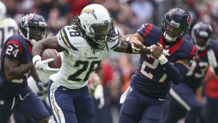 Nov 27, 2016; Houston, TX, USA; San Diego Chargers running back Melvin Gordon (28) rushes as Houston Texans strong safety Quintin Demps (27) defends during the second quarter at NRG Stadium. Mandatory Credit: Troy Taormina-USA TODAY Sports