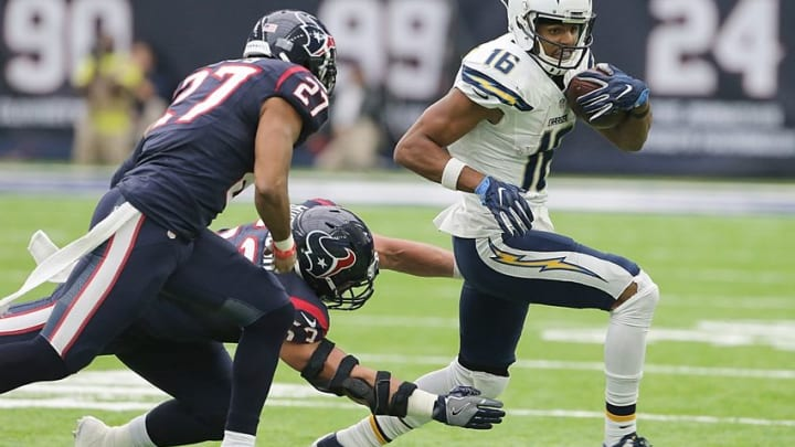 Nov 27, 2016; Houston, TX, USA; San Diego Chargers wide receiver Tyrell Williams (16) breaks the tackle of Houston Texans inside linebacker Max Bullough (53) in the second quarter at NRG Stadium. Mandatory Credit: Thomas B. Shea-USA TODAY Sports