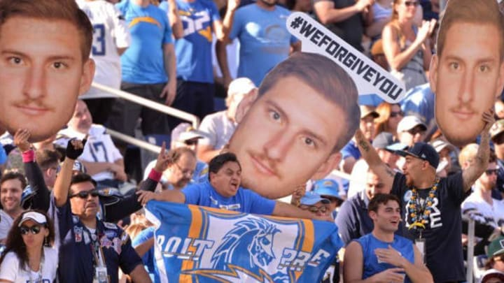 Nov 6, 2016; San Diego, CA, USA; San Diego Chargers fans hold up signs in reference to defensive end Joey Bosa (99) during the second quarter against the Tennessee Titans at Qualcomm Stadium. Mandatory Credit: Orlando Ramirez-USA TODAY Sports