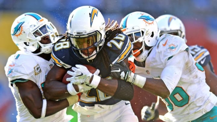 Nov 13, 2016; San Diego, CA, USA; San Diego Chargers running back Melvin Gordon (28) is defended by Miami Dolphins free safety Michael Thomas (31) during the third quarter at Qualcomm Stadium. Mandatory Credit: Jake Roth-USA TODAY Sports