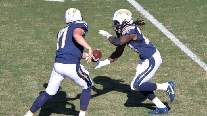 Nov 13, 2016; San Diego, CA, USA; San Diego Chargers quarterback Philip Rivers (17) hands off to running back Melvin Gordon (28) during the first quarter at Qualcomm Stadium. Mandatory Credit: Orlando Ramirez-USA TODAY Sports