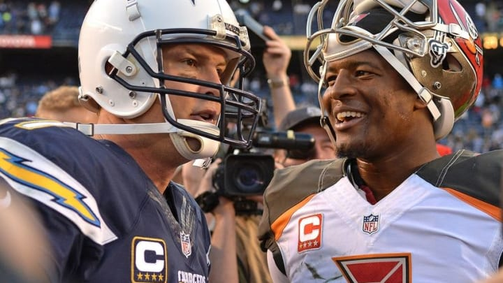Dec 4, 2016; San Diego, CA, USA; Tampa Bay Buccaneers quarterback Jameis Winston (R) talks with San Diego Chargers quarterback Philip Rivers (L) after a 28-21 win over the Chargers at Qualcomm Stadium. Mandatory Credit: Jake Roth-USA TODAY Sports