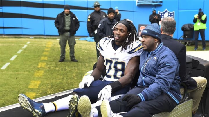 Dec 11, 2016; Charlotte, NC, USA; San Diego Chargers running back Melvin Gordon (28) is taken off the field in the first quarter at Bank of America Stadium. Mandatory Credit: Bob Donnan-USA TODAY Sports