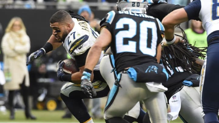 Dec 11, 2016; Charlotte, NC, USA; San Diego Chargers running back Kenneth Farrow (27) runs without a helmet as Carolina Panthers strong safety Kurt Coleman (20) defends in the third quarter at Bank of America Stadium. Mandatory Credit: Bob Donnan-USA TODAY Sports