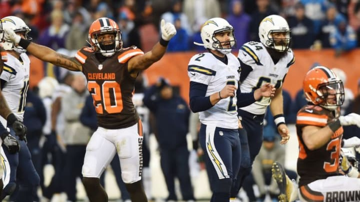Dec 24, 2016; Cleveland, OH, USA; San Diego Chargers kicker Josh Lambo (2) and Cleveland Browns strong safety Briean Boddy-Calhoun (20) react after a field goal was blocked during the fourth quarter at FirstEnergy Stadium. The Browns won 20-17. Mandatory Credit: Ken Blaze-USA TODAY Sports