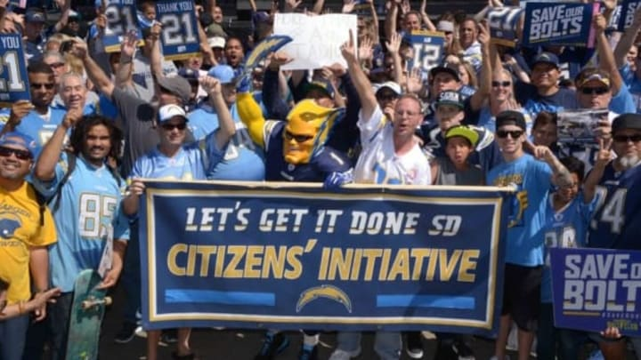Apr 23, 2016; San Diego, CA, USA; San Diego Chargers fan Dan Jauregui aka Boltman poses with Charger fans during rally to gather signatures for citizen