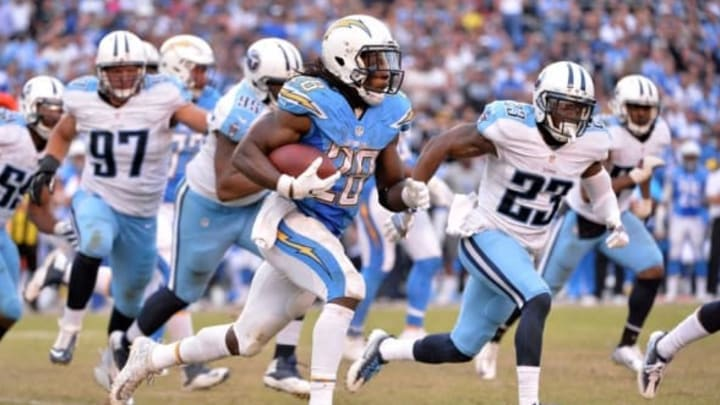 Nov 6, 2016; San Diego, CA, USA; San Diego Chargers running back Melvin Gordon (28) runs the ball as Tennessee Titans defensive back Brice McCain (23) defends during the second half at Qualcomm Stadium. San Diego won 43-35. Mandatory Credit: Orlando Ramirez-USA TODAY Sports