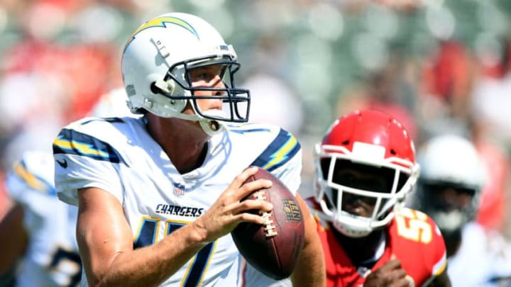 CARSON, CA - SEPTEMBER 09: Philip Rivers #17 of the Los Angeles Chargers scrambles out of the pocket from Dee Ford #55 of the Kansas City Chiefs during the second half at StubHub Center on September 9, 2018 in Carson, California. (Photo by Harry How/Getty Images)