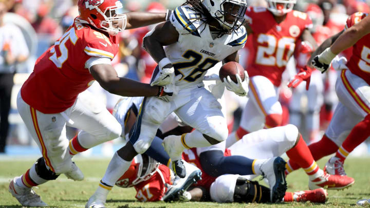 CARSON, CA – SEPTEMBER 09: Melvin Gordon #28 of the Los Angeles Chargers gets tackled by Chris Jones #95 of the Kansas City Chiefs during the second quarter at StubHub Center on September 9, 2018 in Carson, California. (Photo by Harry How/Getty Images)