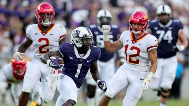 FORT WORTH, TX - SEPTEMBER 29: Jalen Reagor #1 of the TCU Horned Frogs carries the ball against Willie Harvey #2 of the Iowa State Cyclones and Greg Eisworth #12 of the Iowa State Cyclones in the first half at Amon G. Carter Stadium on September 29, 2018 in Fort Worth, Texas. (Photo by Tom Pennington/Getty Images)