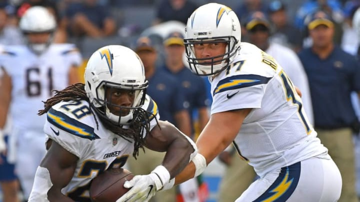 CARSON, CA - SEPTEMBER 30: Quarterback Philip Rivers #17 hands off to running back Melvin Gordon #28 of the Los Angeles Chargers in the game against the San Francisco 49ers at StubHub Center on September 30, 2018 in Carson, California. (Photo by Jayne Kamin-Oncea/Getty Images)