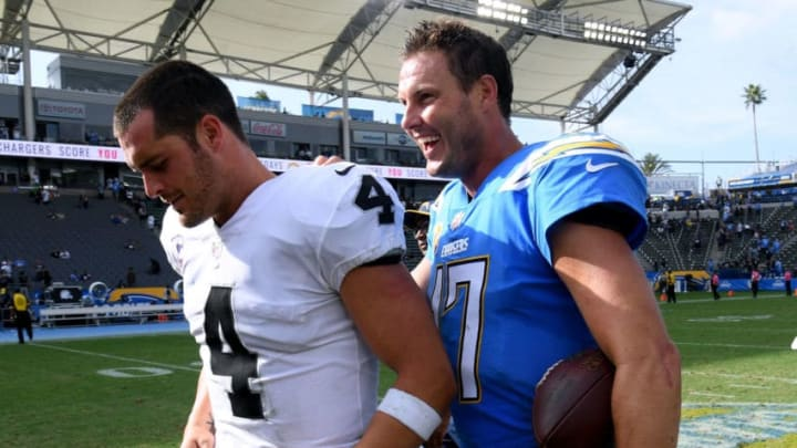 CARSON, CA - OCTOBER 07: Philip Rivers #17 of the Los Angeles Chargers laughs with Derek Carr #4 of the Oakland Raiders after a 26-10 Charger win at StubHub Center on October 7, 2018 in Carson, California. (Photo by Harry How/Getty Images)