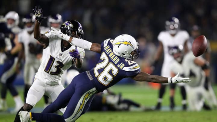 CARSON, CA - DECEMBER 22: Casey Hayward #26 of the Los Angeles Chargers breaks up a pass play intended for John Brown #13 of the Baltimore Ravens during the second half of a game at StubHub Center on December 22, 2018 in Carson, California. (Photo by Sean M. Haffey/Getty Images)