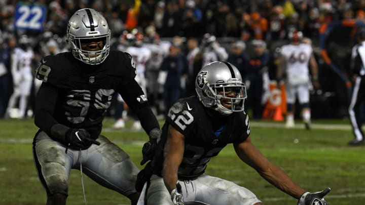 OAKLAND, CA – DECEMBER 24: Arden Key #99 and Rashaan Melvin #22 of the Oakland Raiders celebrate after a turnover against the Denver Broncos during their NFL game at Oakland-Alameda County Coliseum on December 24, 2018, in Oakland, California. (Photo by Robert Reiners/Getty Images)