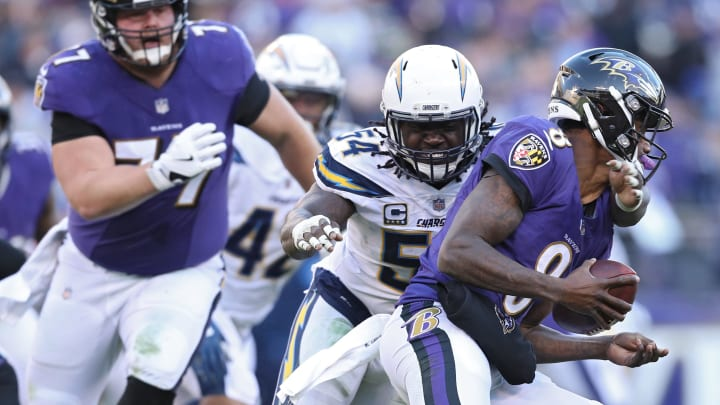 BALTIMORE, MARYLAND – JANUARY 06: Quarterback Lamar Jackson #8 of the Baltimore Ravens is sacked by defensive end Melvin Ingram #54 of the Los Angeles Chargers during the AFC Wild Card Playoff game at M&T Bank Stadium on January 06, 2019, in Baltimore, Maryland. (Photo by Patrick Smith/Getty Images)