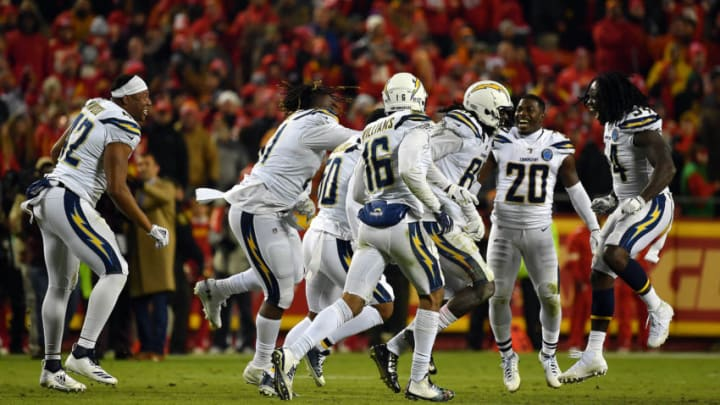 KANSAS CITY, MISSOURI - DECEMBER 13: Wide receiver Mike Williams #81 of the Los Angeles Chargers celebrates with teammates after catching a two point conversion with 4 seconds remaining in the game to put the Chargers up 29-28 on the Kansas City Chiefs at Arrowhead Stadium on December 13, 2018 in Kansas City, Missouri. (Photo by Peter Aiken/Getty Images)