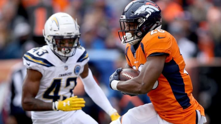 DENVER, COLORADO - DECEMBER 30: Royce Freeman #28 of the Denver Broncos carries the ball against the Los Angeles Chargers at Broncos Stadium at Mile High on December 30, 2018 in Denver, Colorado. (Photo by Matthew Stockman/Getty Images)