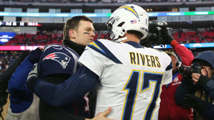 FOXBOROUGH, MASSACHUSETTS - JANUARY 13: Tom Brady #12 of the New England Patriots hugs Philip Rivers #17 of the Los Angeles Chargers after the AFC Divisional Playoff Game at Gillette Stadium on January 13, 2019 in Foxborough, Massachusetts. (Photo by Elsa/Getty Images)