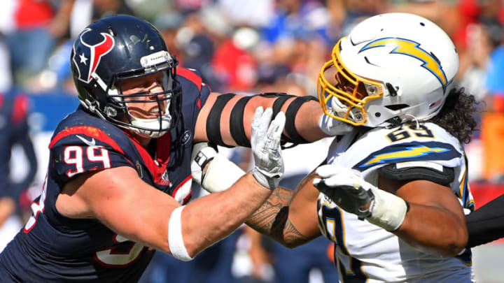 CARSON, CA - SEPTEMBER 22: Offensive tackle Sam Tevi #69 of the Los Angeles Chargers battles defensive end J.J. Watt #99 of the Houston Texans in the second half of the game at Dignity Health Sports Park on September 22, 2019 in Carson, California. (Photo by Jayne Kamin-Oncea/Getty Images)