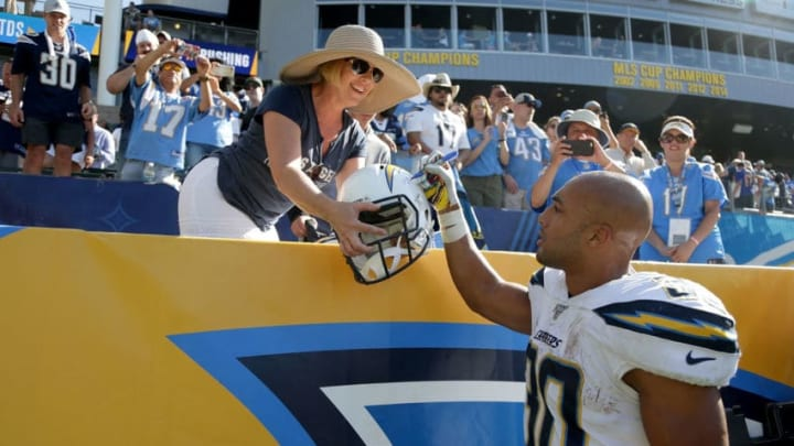 CARSON, CALIFORNIA - SEPTEMBER 08: Austin Ekeler #30 of the Los Angeles Chargers autographs a helmet for a fan following the Chargers 30-24 overtime victory over the Indianapolis Colts at Dignity Health Sports Park on September 08, 2019 in Carson, California. (Photo by Jeff Gross/Getty Images)