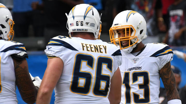 CARSON, CALIFORNIA – SEPTEMBER 22: Wide receiver Keenan Allen #13 of the Los Angeles Chargers celebrates his touchdown in the first quarter with offensive guard Dan Feeney #66 in the game against the Houston Texans at Dignity Health Sports Park on September 22, 2019 in Carson, California. (Photo by Meg Oliphant/Getty Images)
