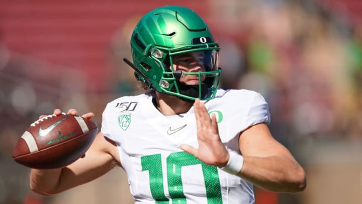 PALO ALTO, CA - SEPTEMBER 21: Justin Herbert #10 of the Oregon Ducks warms up during pregame warm ups prior to the start of an NCAA football game against the Stanford Cardinal at Stanford Stadium on September 21, 2019 in Palo Alto, California. (Photo by Thearon W. Henderson/Getty Images)