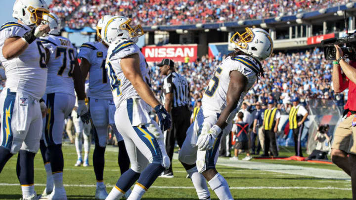 NASHVILLE, TN - OCTOBER 20: Melvin Gordon III #25 and Derek Watt #34 of the Los Angeles Chargers celebrate after a touchdown during a game against the Tennessee Titans at Nissan Stadium on October 20, 2019 in Nashville, Tennessee. The Titans defeated the Chargers 23-20. (Photo by Wesley Hitt/Getty Images)