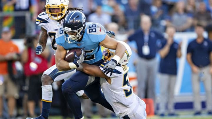 NASHVILLE, TN - OCTOBER 20: Anthony Firkser #86 of the Tennessee Titans is tackled from behind by Emeke Egbule #51 of the Los Angeles Chargers at Nissan Stadium on October 20, 2019 in Nashville, Tennessee. The Titans defeated the Chargers 23-20. (Photo by Wesley Hitt/Getty Images)