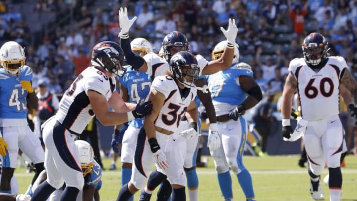 CARSON, CALIFORNIA - OCTOBER 06: Andrew Beck #83 and Connor McGovern #60 congratulate Phillip Lindsay #30 of the Denver Broncos after his rushing touchdown during the first half of a game against the Los Angeles Chargers at Dignity Health Sports Park on October 06, 2019 in Carson, California. (Photo by Sean M. Haffey/Getty Images)