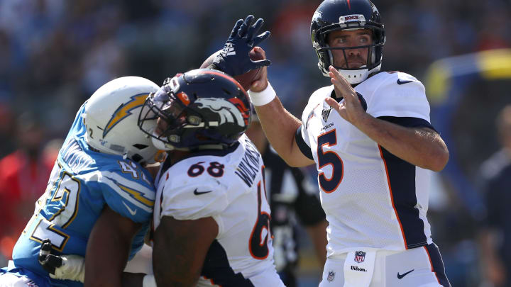 CARSON, CALIFORNIA – OCTOBER 06: Joe Flacco #5 of the Denver Broncos passes the ball under pressure from Uchenna Nwosu #42 of the Los Angeles Chargers during the first half of a game at Dignity Health Sports Park on October 06, 2019 in Carson, California. (Photo by Sean M. Haffey/Getty Images)