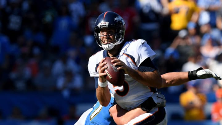 CARSON, CALIFORNIA - OCTOBER 06: Joe Flacco #5 of the Denver Broncos reacts as he is sacked by Joey Bosa #97 of the Los Angeles Chargers during the fourth quarter in a 20-13 Broncos win at Dignity Health Sports Park on October 06, 2019 in Carson, California. (Photo by Harry How/Getty Images)
