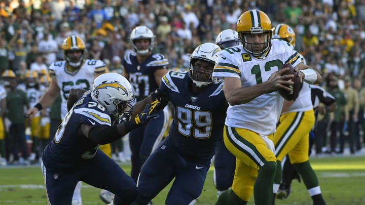 CARSON, CA – NOVEMBER 03: Aaron Rodgers #12 of the Green Bay Packers scrambles past Thomas Davis #58 and Jerry Tillery #99 of the Los Angeles Chargers for a two-point conversion in the fourth quarter at Dignity Health Sports Park on November 3, 2019 in Carson, California. (Photo by John McCoy/Getty Images) Chargers won 26-11.