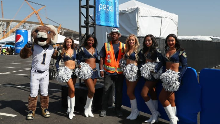 INGLEWOOD, CALIFORNIA – OCTOBER 10: A fan poses for a photo with Rampage and the Rams cheerleaders at the PepsiCo SoFi Stadium and Hollywood Park Partnership Inaugural Tailgate Celebration on October 10, 2019, in Inglewood, California. (Photo by Rich Polk/Getty Images for PepsiCo)