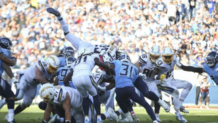 NASHVILLE, TENNESSEE - OCTOBER 20: Melvin Gordon III #25 of the Los Angeles Chargers dives over players in an attempt to score a touchdown against the Tennessee Titans during the second quarter at Nissan Stadium on October 20, 2019 in Nashville, Tennessee. (Photo by Silas Walker/Getty Images)