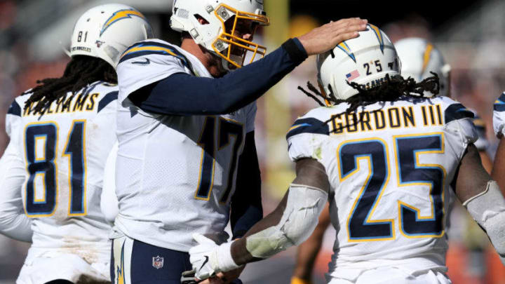 CHICAGO, ILLINOIS - OCTOBER 27: Philip Rivers #17 and Melvin Gordon III #25 of the Los Angeles Chargers celebrate after Gordon III scored a touchdown in the second quarter against the Chicago Bears at Soldier Field on October 27, 2019 in Chicago, Illinois. (Photo by Dylan Buell/Getty Images)